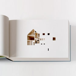 Olafur Eliasson's Your House, commissioned by the Library Council of MOMA. The book is a laser-cut negative impression of his house in Copenhagen. Each of the 454 pages individually cut, corresponds to 2.2 cm of the actual house.