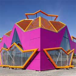 A colorful postmodern building by Mi5 Arquitectos for a new Youth Center in Madrid, Spain. The wicked design is the result of workshop with local teenagers.