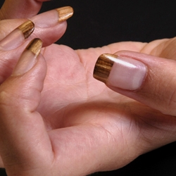 Nail extensions in exotic wood veneers by Nanna Natural.