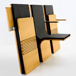 The JumpSeat from Ziba is an elegant auditorium chair that looks beautiful when folded down or tucked away.