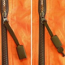 Zipper pull hidden handcuff key
