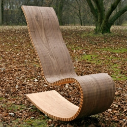zipshape is a universal fabrication method to fabricate single curved panels from any plain material without molds. 'ziprocker' rocking chair by hamburg school of timber technology and swiss office schindlersalmerón on display at imm cologne Jan 19-25.