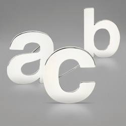 I couldn't wait any longer to post this.... Helvetica Brooches by Zoe Ikin.
